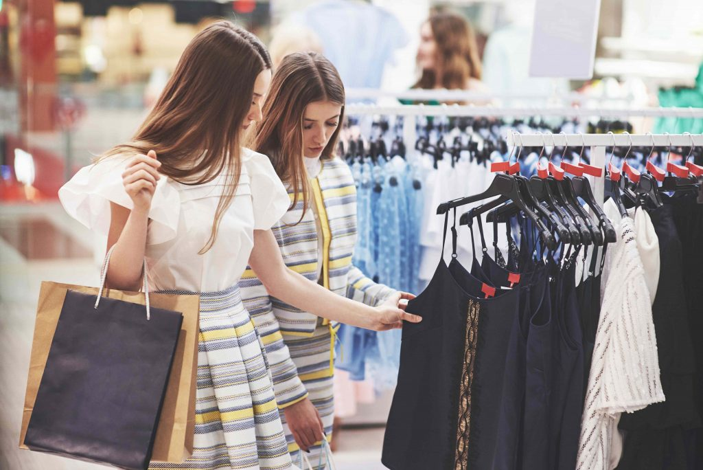 Footfall traffic people counting solution - best friends together spend time two beautiful girls make purchases clothing store they dressed same clothes 1024x684 - People Counting Solutions to optimize mall operations.