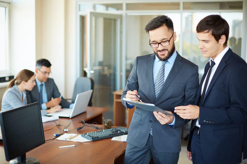 workforce management software employee scheduling software - successful businessmen talking each other 1 1024x683 - Choose the best employee scheduling software-Complete checklist